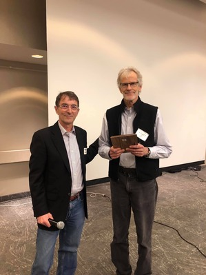 Board Chair Andrew Streitz presenting 10-yr board service award to Steve Wilson Oct 2019